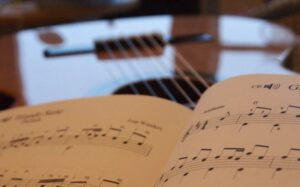 learning music theory from music score on an acoustic guitar