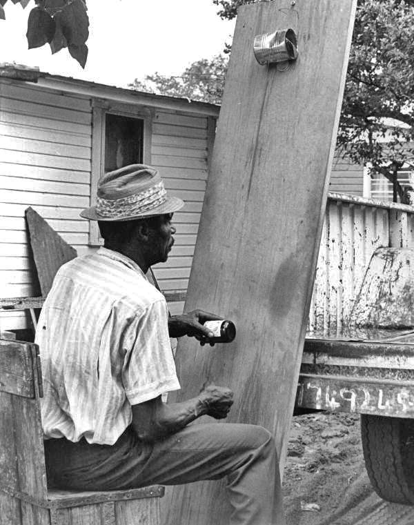 African American man playing a diddley-bow, a part of African American music history