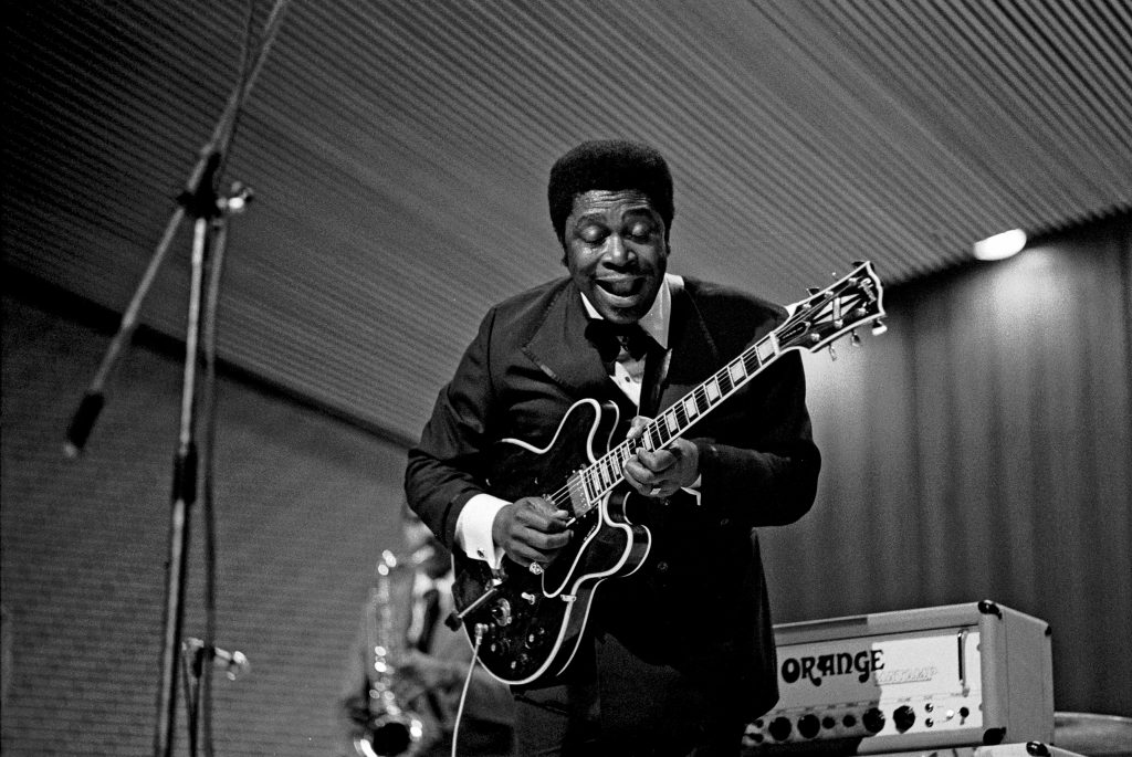 one of the greatest blues guitar players in history BB King playing on stage at a music club