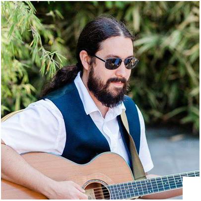 Profile shot of Sam Grant guitar and Ukelele teacher from Gosport