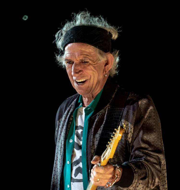 Keith Richards playing on stage