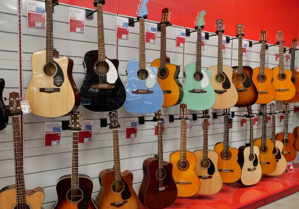 wall of acoustic guitars in a music store
