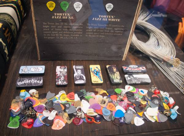 plectrum display table at a guitar show showing various shapes and types